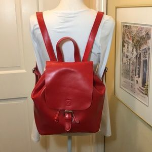 Red leather backpack. CoLab